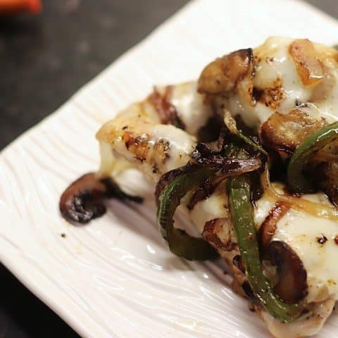 Grilled chicken with sauteed peppers, mushrooms, and onions covered with Provolone cheese