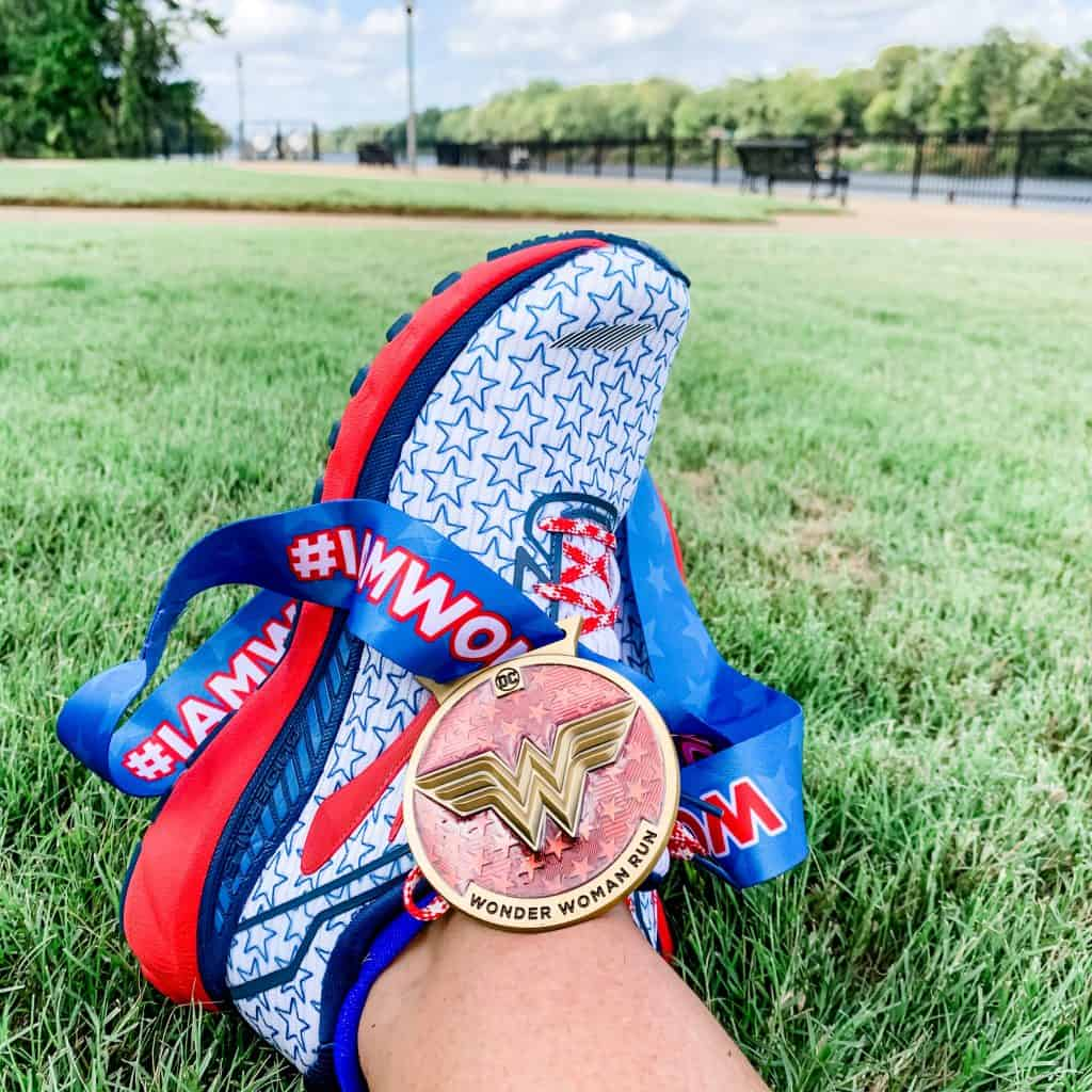 Running shoe with medal on top